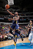 Donald Sloan of the Indiana Pacers goes in for the layup against the Dallas Mavericks on November 24 2014 at the American Airlines Center in Dallas...