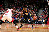 Donald Sloan of the Indiana Pacers handles the ball against Aaron Brooks of the Chicago Bulls on March 18 2015 at the United Center in Chicago...