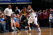 Donald Sloan of the Indiana Pacers handles the ball against Jameer Nelson of the Dallas Mavericks on October 12 2014 at the American Airlines Center...