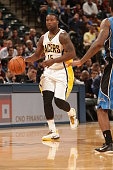 Donald Sloan of the Indiana Pacers handles the ball during the game against the Orlando Magic at Bankers Life Fieldhouse on October 10 2014 in...