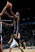 Donald Sloan of the Indiana Pacers shoots against the San Antonio Spurs at the ATT Center on November 26 2014 in San Antonio Texas NOTE TO USER User...