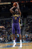 Donald Sloan of the New Orleans Hornets goes for a jump shot during the game between the New Orleans Hornets and the Portland Trail Blazers on...