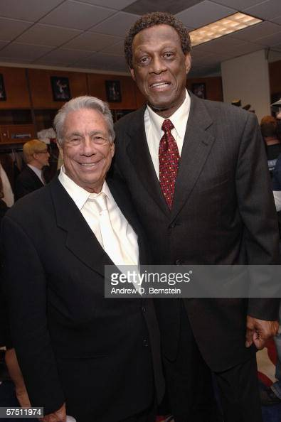 Donald Sterling Owner and CEO of the Los Angeles Clippers embraces GM Elgin Baylor after the win against the Denver Nuggets in game five of the...