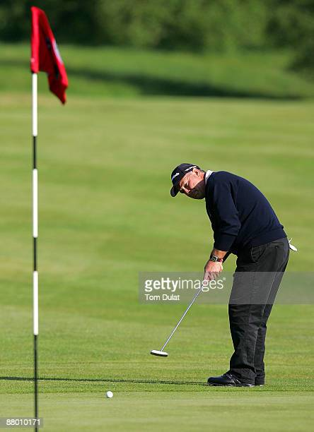 Donald Stirling of Wien Sussenbrunn makes a putt on the 18th green during the Senior PGA Professional Championship at The Northants County Golf Club...