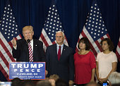 Donald Trump 2016 Republican presidential nominee left speaks as Mike Pence 2016 Republican vice presidential nominee listens during a goodbye...