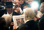 Donald Trump 2016 Republican presidential nominee right views a photo of himself on the cover of the New York Times during a goodbye reception at the...
