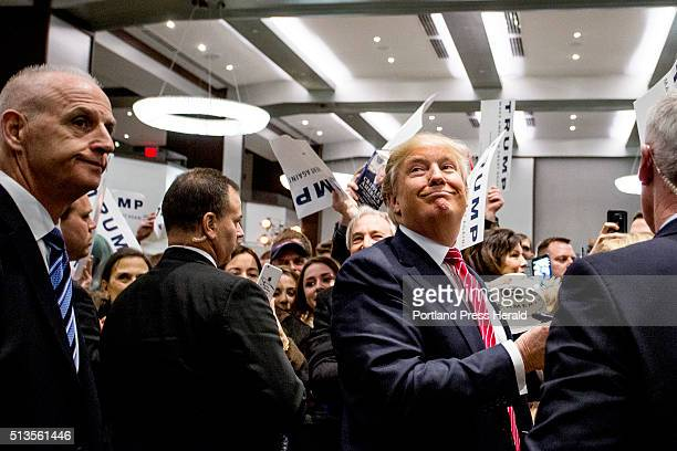 Donald Trump acknowledged the media behind him as he signed autographs after speaking at the Westin Portland Harborview Hotel in Portland Thursday...