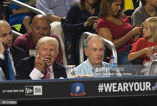 Donald Trump and Bill O'Reilly drink milkshakes during a New York Yankees game against the Oakland Athletics on August 30 2010 at Yankee Stadium in...