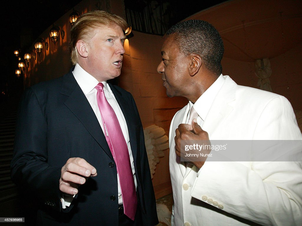 Donald Trump and Bob Johnson during Art for Life Gala Honoring Sean P. Diddy Combs Hosted by Russell Simmons and Kimora Lee Simmons at Mar-a-Lago in Palm Beach, Florida, United States.