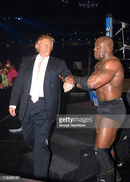 Donald Trump and Bobby Lashley leave the ring after winning the 'Battle of the Billionaires' match at Ford Field at Wrestlemania 23