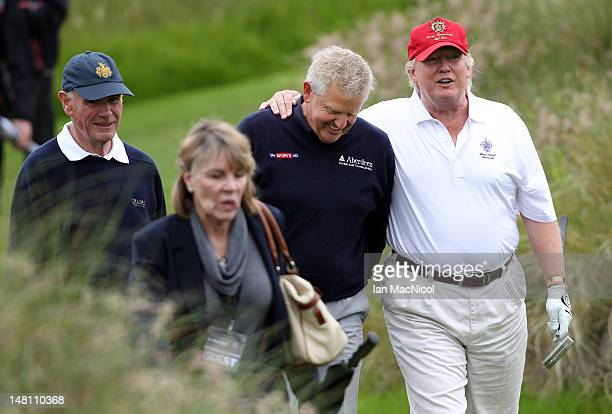 Donald Trump and Colin Montgomerie share a joke after the opening of The Trump International Golf Links Course on July 10 2012 in Balmedie Scotland...