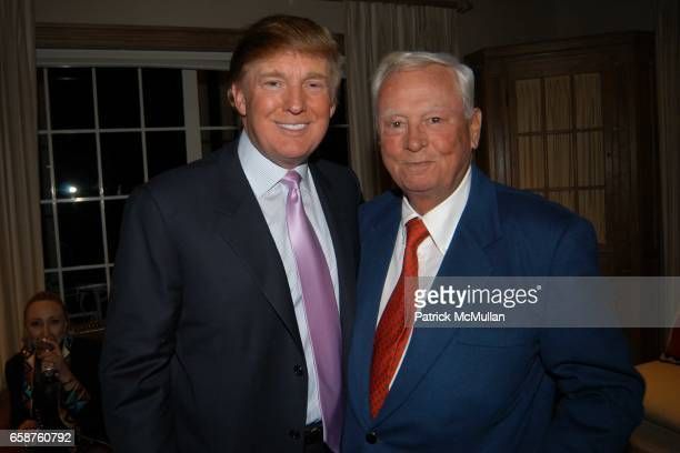 Donald Trump and Conrad Hilton attend Kathy and Rick Hilton's party for Donald Trump and 'The Apprentice' at the Hiltons' Home on February 28 2004 in...