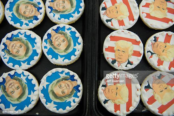 Donald Trump and Hillary Clinton cookies are on sale at the Oakmont Bakery on November 8 2016 in Oakmont Pennsylvania Trump leads the cookiepurchase...