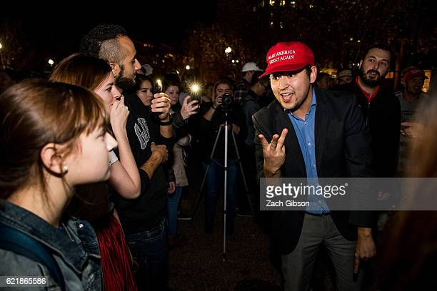 Donald Trump and Hillary Clinton supporters argue in front of The White House while waiting for 2016 election return updates on November 9 2016 in...