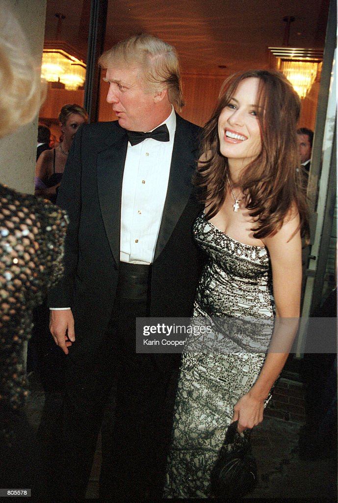 Donald Trump and his girlfriend Melania Knauss attend a reception before the annual White House Correspondents Dinner April 28, 2001 in Washington, DC.