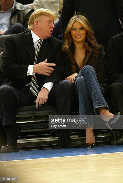 Donald Trump and his new wife Melania Trump sit courtside during the Miami Heat and New York Knicks NBA game on March 15 2005 at Madison Square...