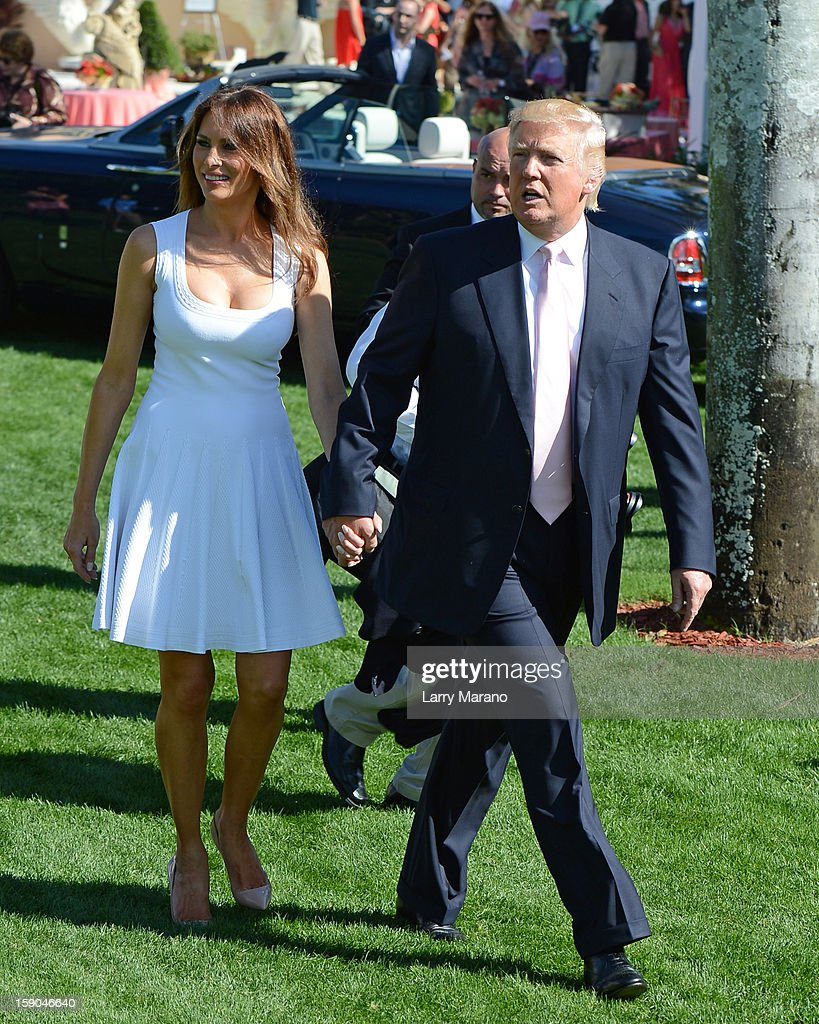 <a gi-track='captionPersonalityLinkClicked' href=/galleries/search?phrase=Donald+Trump+-+Born+1946&family=editorial&specificpeople=118600 ng-click='$event.stopPropagation()'>Donald Trump</a> and his wife Melania attend Trump Invitational Grand Prix at Mar-a-Lago on January 6, 2013 in Palm Beach, Florida.