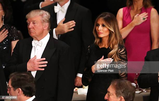 Donald Trump and his wife Melania Trump attend the annual Alfred E Smith Memorial Foundation Dinner at the Waldorf Astoria on October 20 2016 in New...