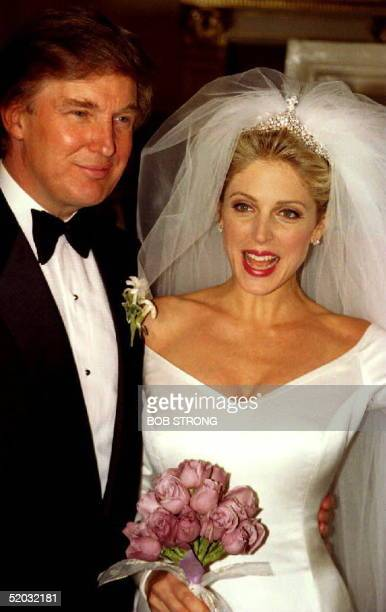 Donald Trump and Marla Maples appear in front of the press 21 December 1993 after marrying in a lavish and private wedding ceremony at Trump's Plaza...