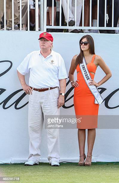 Donald Trump and Miss Universe Paulina Vega are seen around Trump National Doral on March 5 2015 in Miami Florida