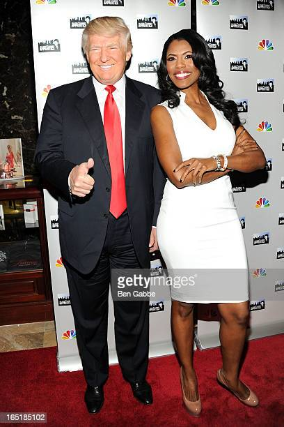 Donald Trump and Omarosa Manigault attend the 'AllStar Celebrity Apprentice' Red Carpet Event at Trump Tower on April 1 2013 in New York City