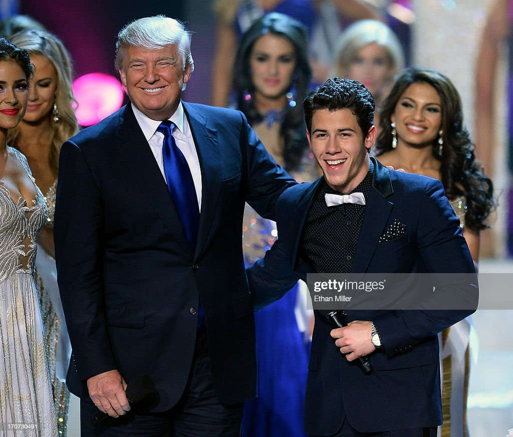 Donald Trump (L) and recording artist and host Nick Jonas joke around onstage during the 2013 Miss USA pageant at PH Live at Planet Hollywood Resort & Casino on June 16, 2013 in Las Vegas, Nevada.