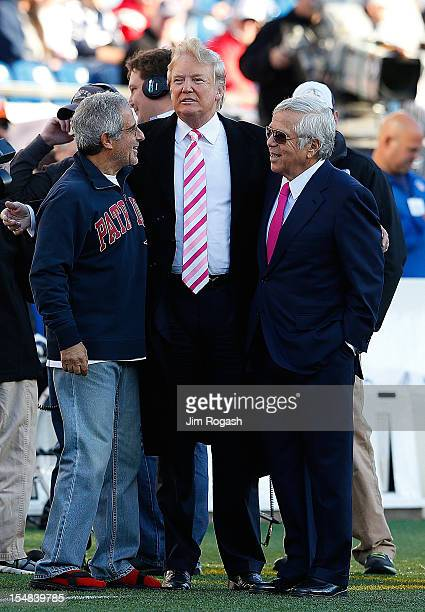 Donald Trump and Robert Kraft talk before a game between the New England Patriots and New York Jets at Gillette Stadium on October 21 2012 in Foxboro...