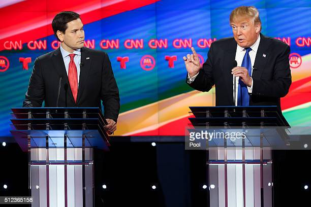 Donald Trump and Sen Marco Rubio participate in the Republican presidential debate at the Moores School of Music at the University of Houston on...