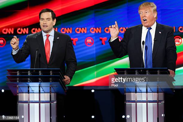 Donald Trump and Sen Marco Rubio talk over each other at the Republican presidential debate at the Moores School of Music at the University of...