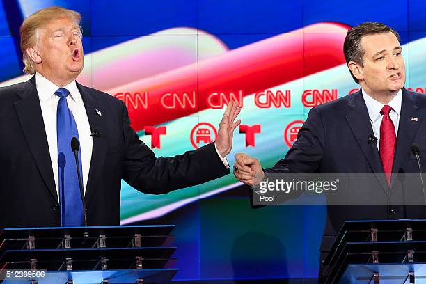 Donald Trump and Sen Ted Cruz talk over each other in the Republican presidential debate at the Moores School of Music at the University of Houston...