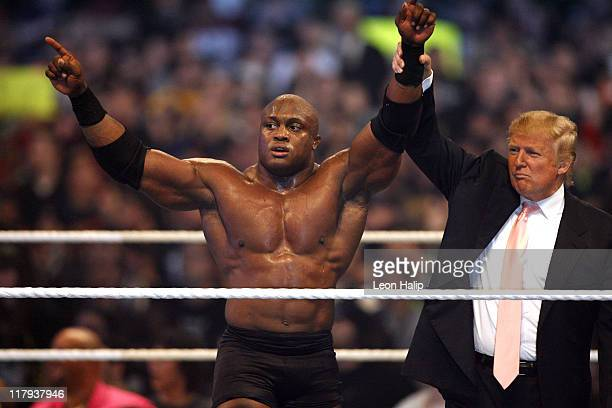 Donald Trump and WWE wrestler Bobby Lashley celebrate their victory over Vince McMahon at the main event of the night 'Hair vs Hair' between Vince...
