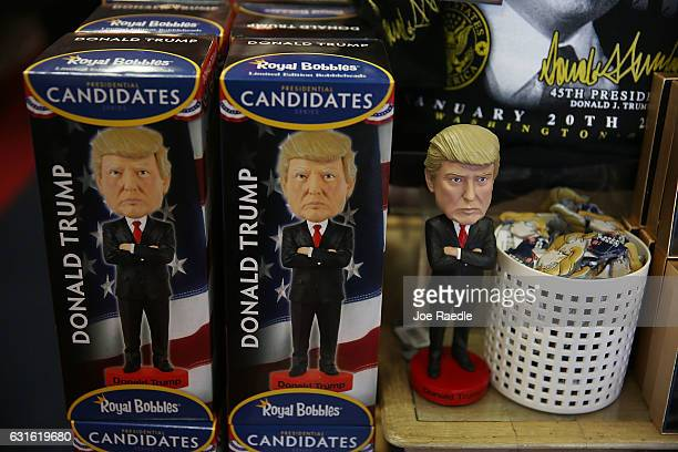 Donald Trump bobble head dolls are seen for sale on the store shelf of White House Gifts as President elect Donald Trump prepares to take the reins...