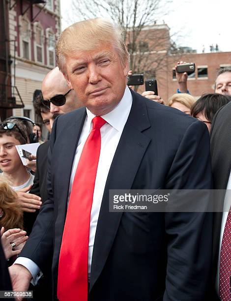 Donald Trump doing a walking tour of Portsmouth NH with his private security people while campaigning on April 27 2011