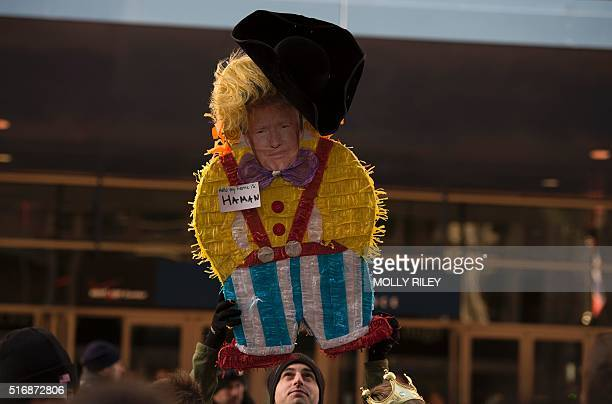 A Donald Trump effigy is hoisted outside Verizon Center as protesters gathered during the AIPAC 2016 Policy Conference on March 21 2016 in Washington...