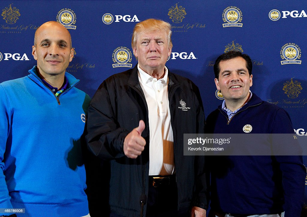 Donald Trump flashes a thumbs up as he poses with Pete Bevacqua Chief Executive Officer of the PGA of America and Derek Sprague President of PGA...