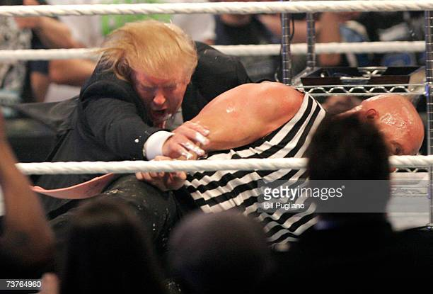 Donald Trump gets taken to the mat by 'Stone Cold' Steve Austin after the the Battle of the Billionaires at the 2007 World Wrestling Entertainment's...