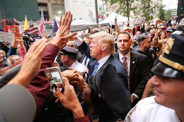 Donald Trump greets supporters outside of Trump Towers in Manhattan October 8 2016 in New York City The Donald Trump campaign has faced numerous...