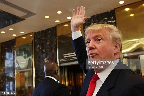 Donald Trump greets supporters tourists and the curious after taping an interview with Anderson Cooper at a Trump owned building in midtown Manhattan...
