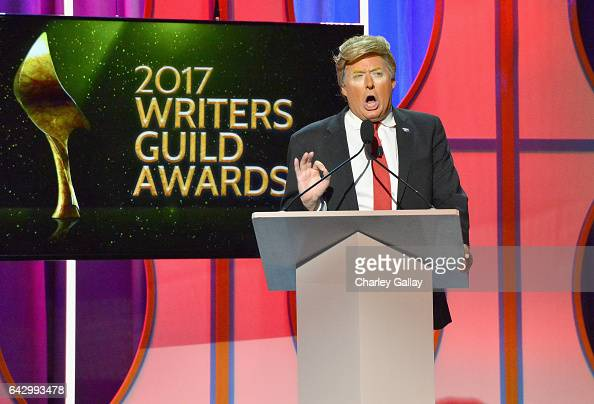 Donald Trump impersonator speaks onstage during the 2017 Writers Guild Awards LA Ceremony at The Beverly Hilton Hotel on February 19 2017 in Beverly...