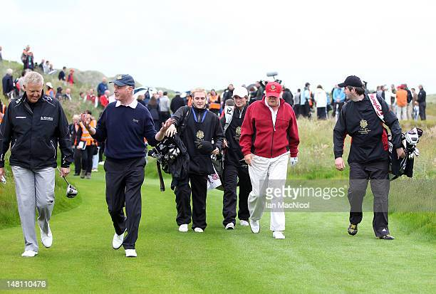 Donald Trump is accompanied by the media during the opening of The Trump International Golf Links Course on July 10 2012 in Balmedie Scotland The...