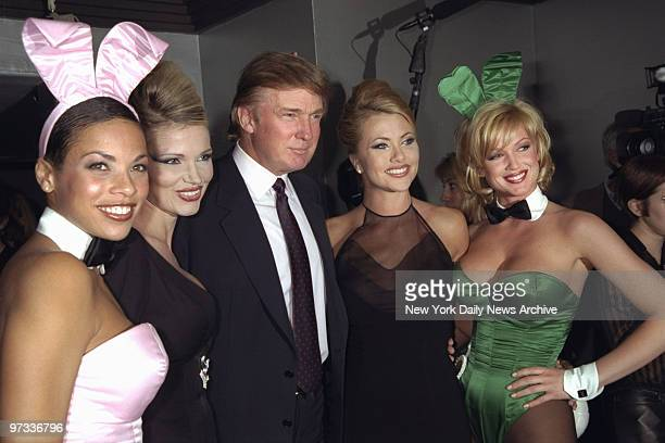 Donald Trump is flanked by Playmates at a party celebrating Playboy magazine's 45th anniversary at the Life Club