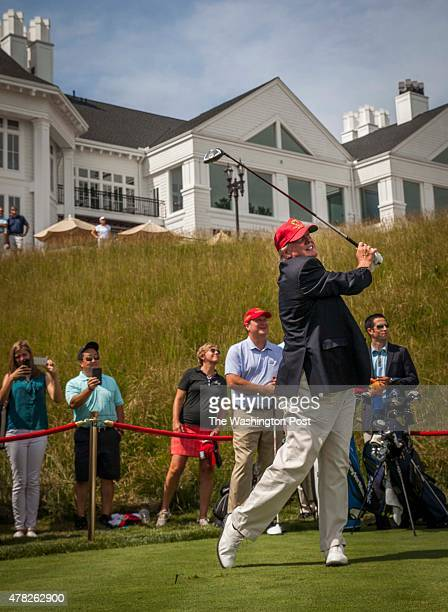Donald Trump joins in the celebration of the opening of his championship golf course in Sterling VA June 23