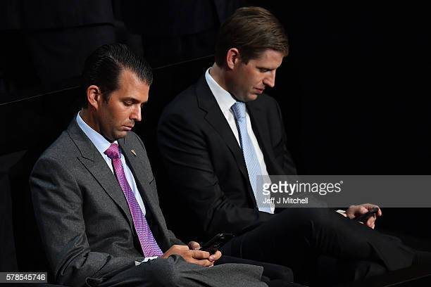 Donald Trump Jr and Eric Trump check their phones during the evening session on the fourth day of the Republican National Convention on July 21 2016...