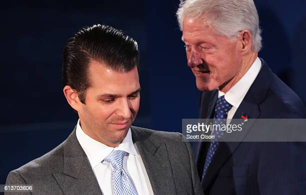 Donald Trump Jr and former US President Bill Clinton greet each other before the town hall debate at Washington University on October 9 2016 in St...