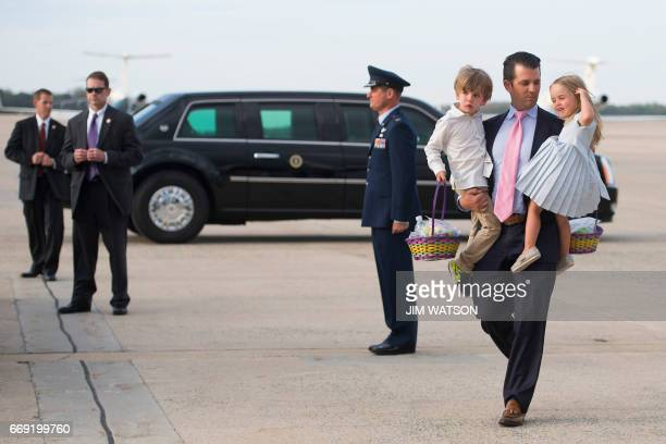 CORRECTION Donald Trump Jr holds his daughter Chloe and son Donald Trump III as they walk off Air Force One at Andrews Air Force Base MD April 16...
