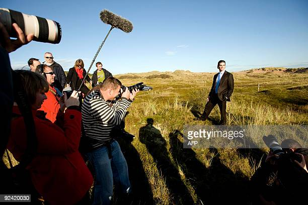 Donald Trump Junior poses for photographs as work begins on the golf course being built by his father US tycoon Donald Trump in Balmedie near...