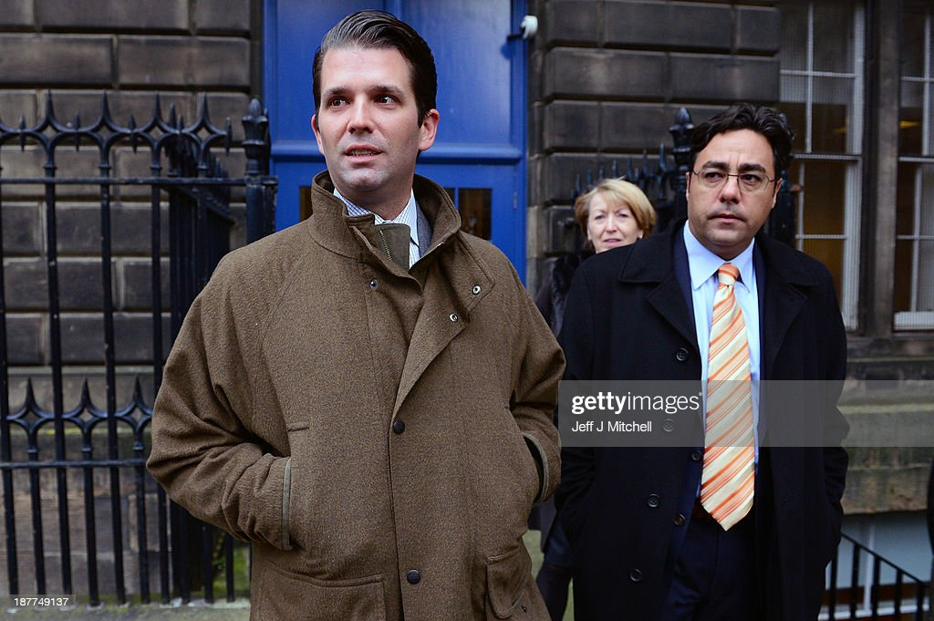 Donald Trump Junior speaks to the media with George Sorial (R) outside the Edinburgh Court of Session where a four day hearing has begun, challenging plans for an offshore wind farm near his fathers Balmedie golf course on November 12, 2013 in Edinburgh, Scotland. The U.S business tycoon Donald Trump and his legal team are attempting to overturn the decision by the Scottish Government to approve an 11 turbine project in Aberdeen bay, claiming it would spoil the view at his luxury golf resort.