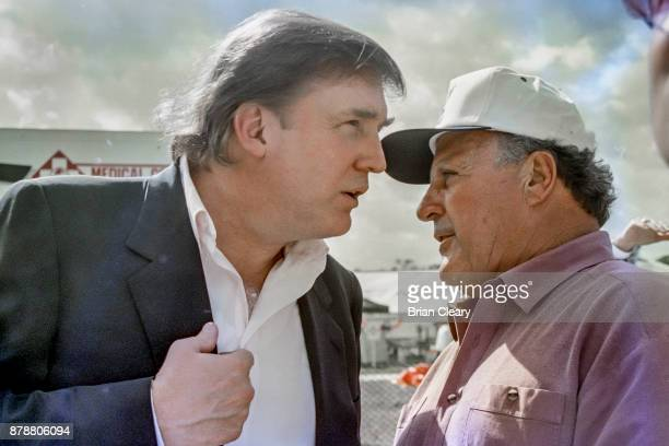 Donald Trump L talks with IndyCar racing legend A J Foyt Jr before the Indy 200 Indy Racing League IRL race at Walt Disney World Speedway Speedway on...