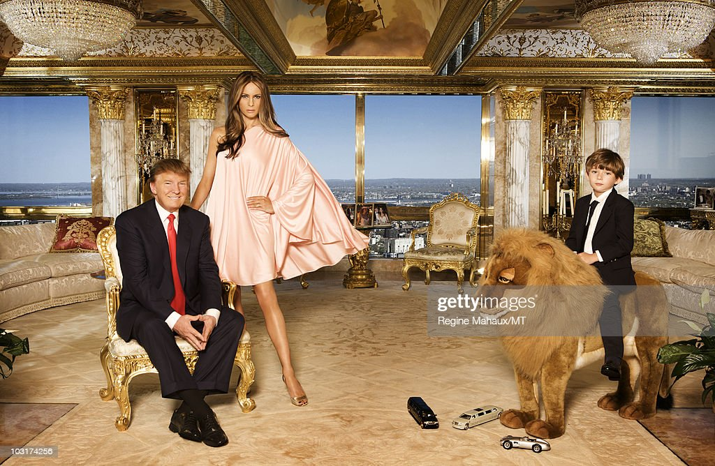 Donald Trump, Melania Trump and their son Barron Trump pose for a portrait on April 14, 2010 in New York City. Donald Trump is wearing a suit and tie by Brioni, Melania Trump is wearing a dress by Halston, shoes by Manolo Blahnik, makeup by Mykel Renner for Kett Cosmetics and hair by Mordechia for yarokhair.com., Barron Trump is wearing a jacket and pants by Papo d'Anjo, shirt by Leon and shoes by Todds.