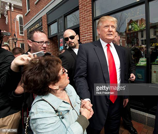 Donald Trump on a walking tour of Portsmouth NH with his private security people while campaigning on April 27 2011